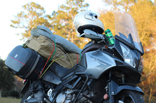 Camper Supply - a motorcycle loaded with camping gear.